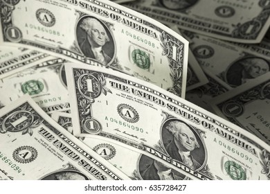 One us dollar bills background. Two dollar bills staying on another. Close up image. Selective focus.