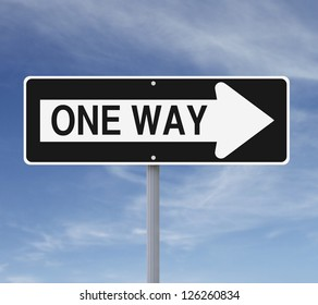 One way sign against a blue sky background