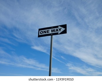 One Way Sign and Blue Skies