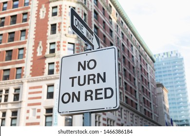 One way sign and No turn on red in Boston, USA