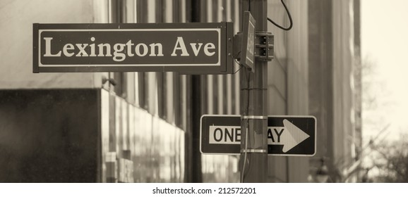 One way and street name sign in Manhattan - New York City.
