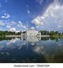 One of the well known mosque located in Terengganu, Malaysia. the Floating mosque in the sunny day with the reflection.