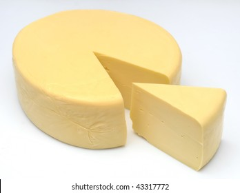 one wheel round cheese with one slice