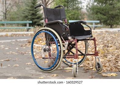 One wheelchair outdoors in a fall landscape