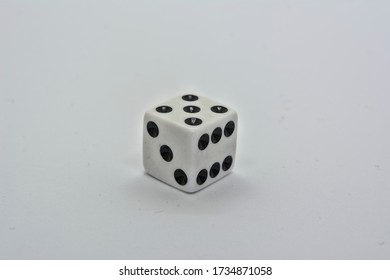 One white dice showing five on white background
