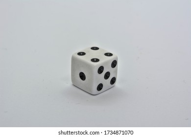One white dice showing four on white background