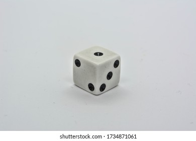 One white dice showing one on white background