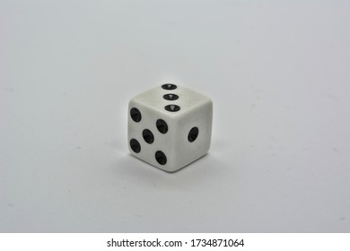 One white dice showing three on white background