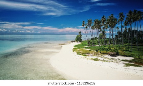 one of the white sand beaches of the tropical islands around Sabah, Borneo, Malaysia