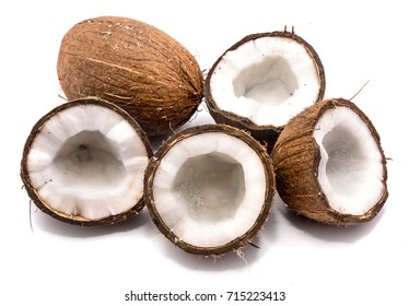 One whole coconut and four halves isolated on white background