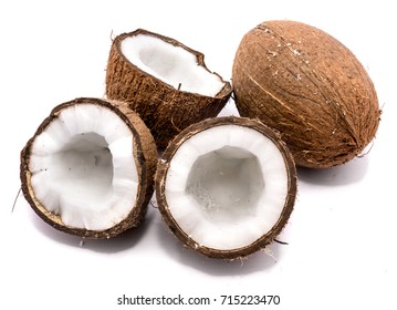One whole coconut and three halves isolated on white background