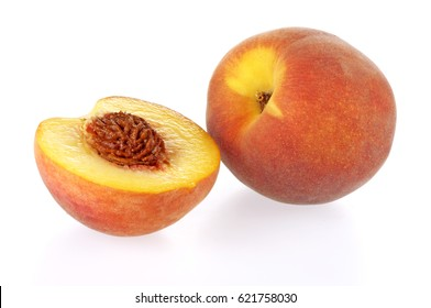 ONE WHOLE FRESH PEACH AND ONE CUT HALF ON WHITE
