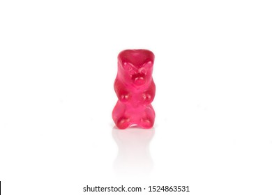 One whole red gummy bear isolated on white background