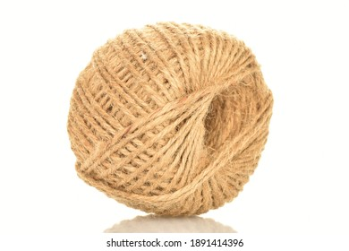 One whole skein of jute thread, close-up, isolated on white.