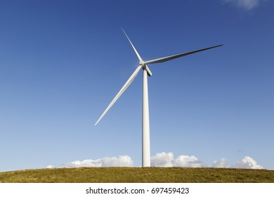 One Wind Turbine with a blue sky background