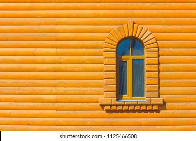 One window on the wall. A wooden wall with one window.