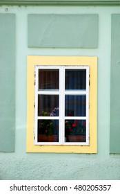 One Window Yellow Frame in Green