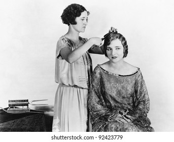One woman doing another woman's hair