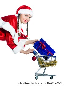 one woman dressed as santa claus holding presents gifts with christmas shopping cart on studio isolated white background