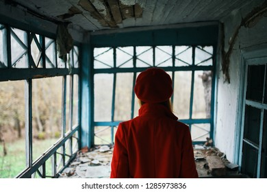 one woman in an empty house in the forest