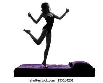 one  woman happy thumb up standing on bed silhouette studio on white background