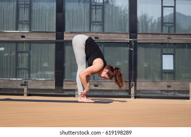 one woman on hotel roof doing yoga fitness