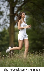one woman running in a park