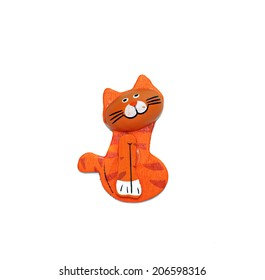 One wooden cat figure brightly painted in orange