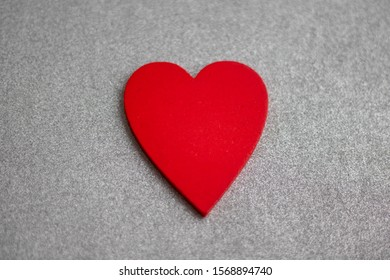 One wooden heart isolated on silver background.