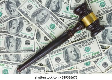 one Wooden Law Gavel on Dollar Money background