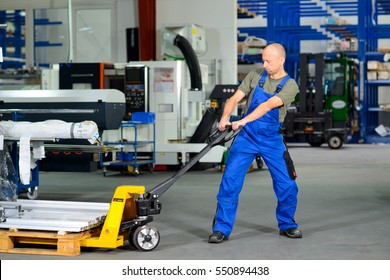 one worker in factory with hand lift