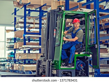 one worker in factory in lift truck with thumb up