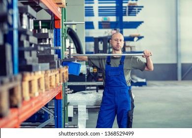one worker in factory in stockroom