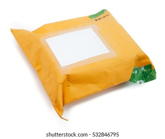 One wrapped up parcels,  in an envelope, on a white background, with blank label and green recycled parcel tape. Ready to post.