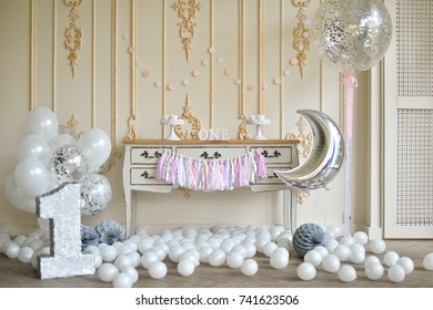 One year birthday decorations ideas. A lot of balloons white color.