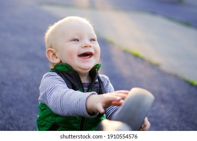 one year boy smile in a playground has a fun. Smiling boy child.