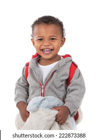 One Year Old Adorable African American Boy Laughing Holding Blanket and Carrying Backpack Isolated  on White Background