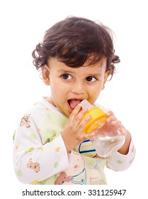 One year old baby boy drinking watter with sipper on white background Mumbai, Maharashtra, India, Southeast Asia.