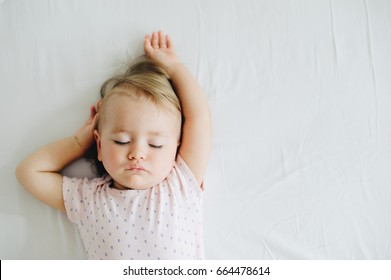 One year old baby girl sleeping.
