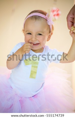 One Year Old Baby Girl Celebrating Her First Birthday Wearing A Personalized 1 T