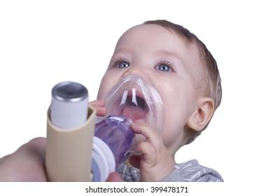One year old boy using an asthma inhalator