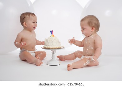One Year Old Twin Boys Wearing Diapers And Eating Birthday Cake The Cleaner Of