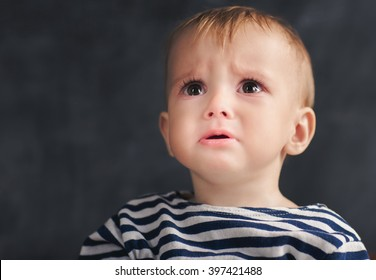 One year toddler afraid something ore someone and looking up