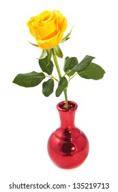 One yellow rose in metallic red vase isolated over white
