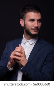 one young adult man, 20s model, good looking face head close up, elegant suit hand gesture fists fingers closed together