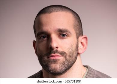 One Young Adult Man Sad, Red Eyes, Looking At Camera, Short Hair,