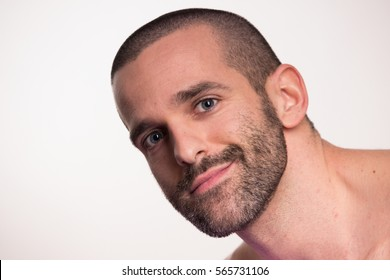 one young adult man  short hair, looking at camera smiling, white background, shirtless, closeup