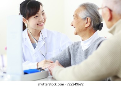 one young asian female doctor doing health check to senior Chinese woman, senior people health care