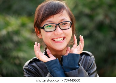 one young asian girl in black jack smile at camera