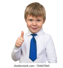 One young boy in a white shirt and a tie. Smiling and showing a finger to the top. Blue eyes, blond, Caucasian